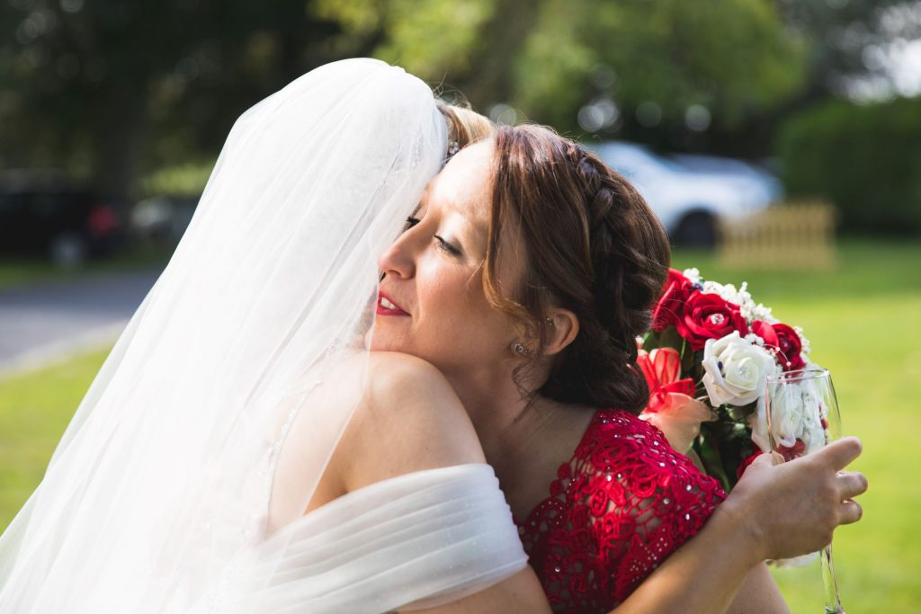 bride hugs bridesmaid wroxeter hotel gardens shrewsbury shropshire oxfordshire wedding photographers