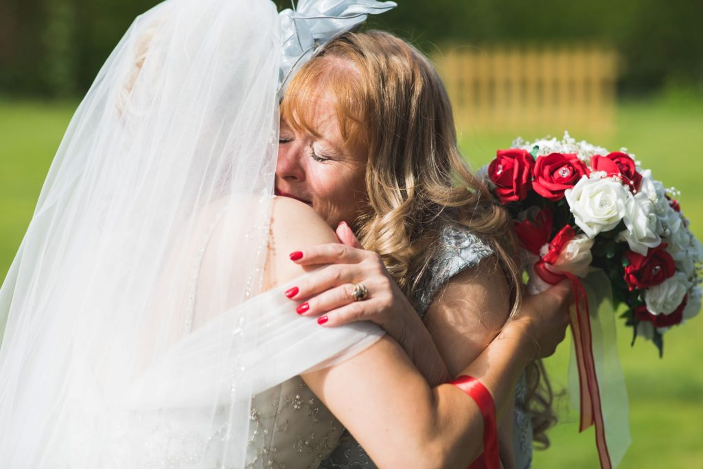 mother of bride hugs bride wroxeter hotel shrewsbury shropshire oxfordshire wedding photography