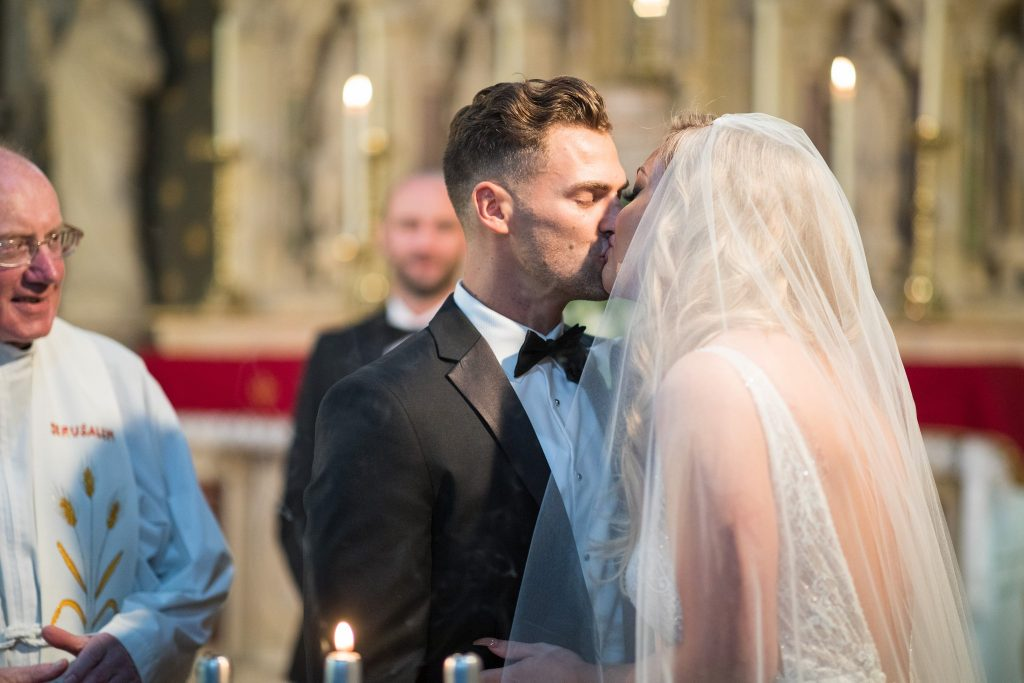 bride groom first kiss st marys catholic church husbands bosworth leicestershire oxford wedding photographer