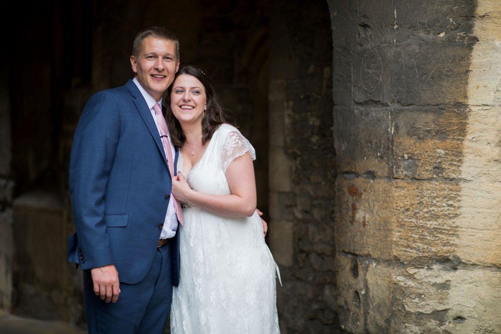 smiling bride groom alone registry office ceremony roysse court abingdon oxfordshire oxford wedding photography