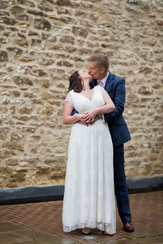 bride groom kiss outside registry office ceremony roysse court abingdon oxford wedding photography