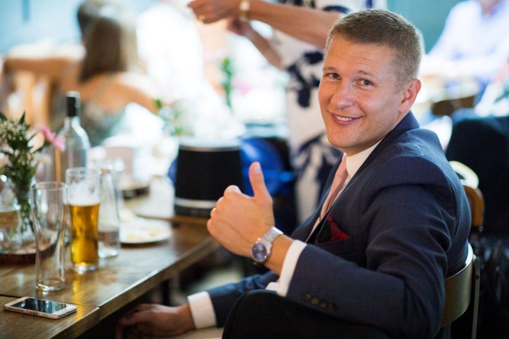 grooms thumbs up broad face pub reception abingdon oxfordshire wedding photographer