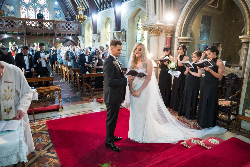 bride groom bridesmaids guests sing marriage ceremony st marys catholic church husbands bosworth leicestershire oxford wedding photography