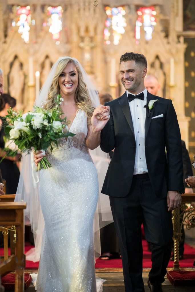 bride groom walk down aisle st marys catholic church husbands bosworth leicestershire oxfordshire wedding photographers