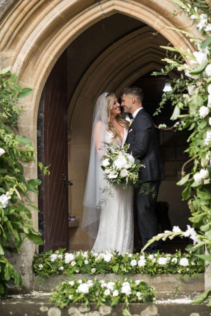 bride groom kiss under archway st marys catholic church husbands bosworth leicestershire oxfordshire wedding photography