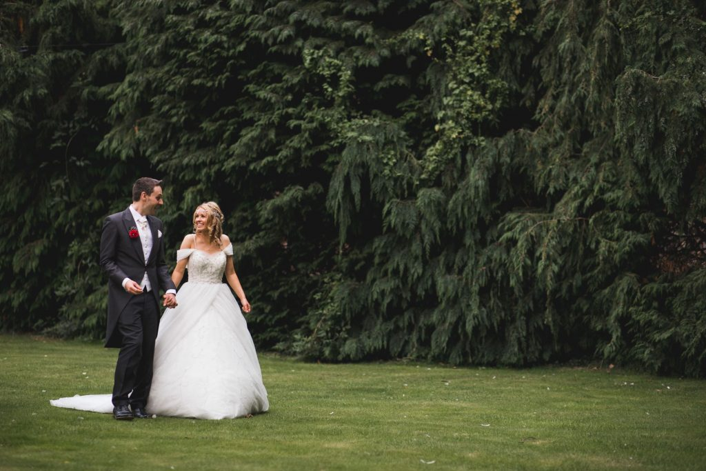 bride groom walk alone wroxeter hotel shrewsbury shropshire gardens oxford wedding photographers