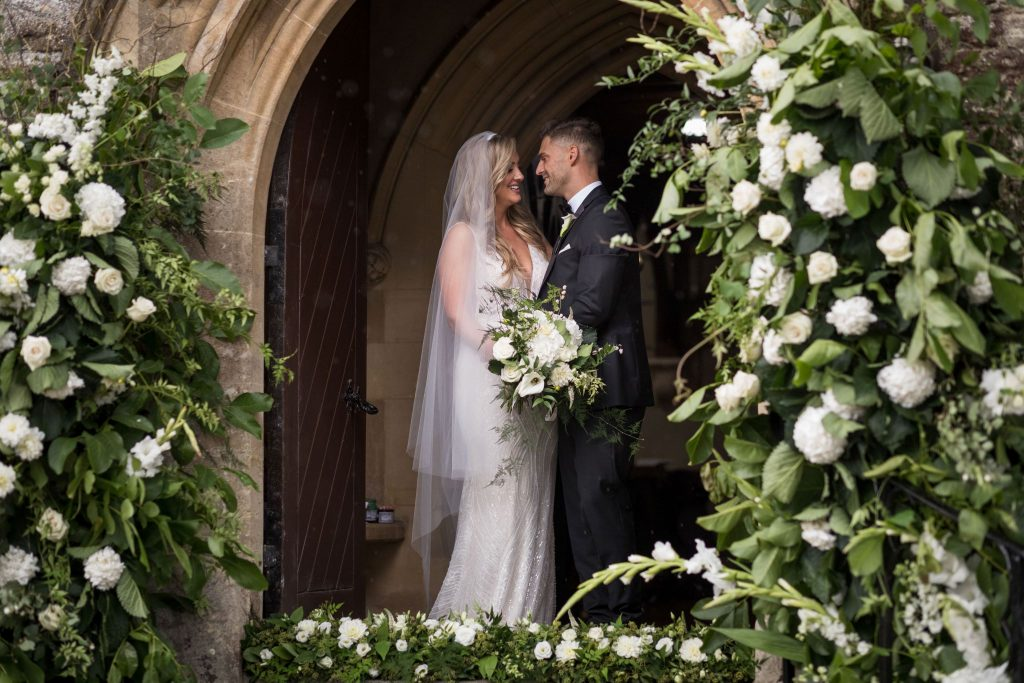 groom bride kiss church archway st marys husbands bosworth leicestershire oxford wedding photographer