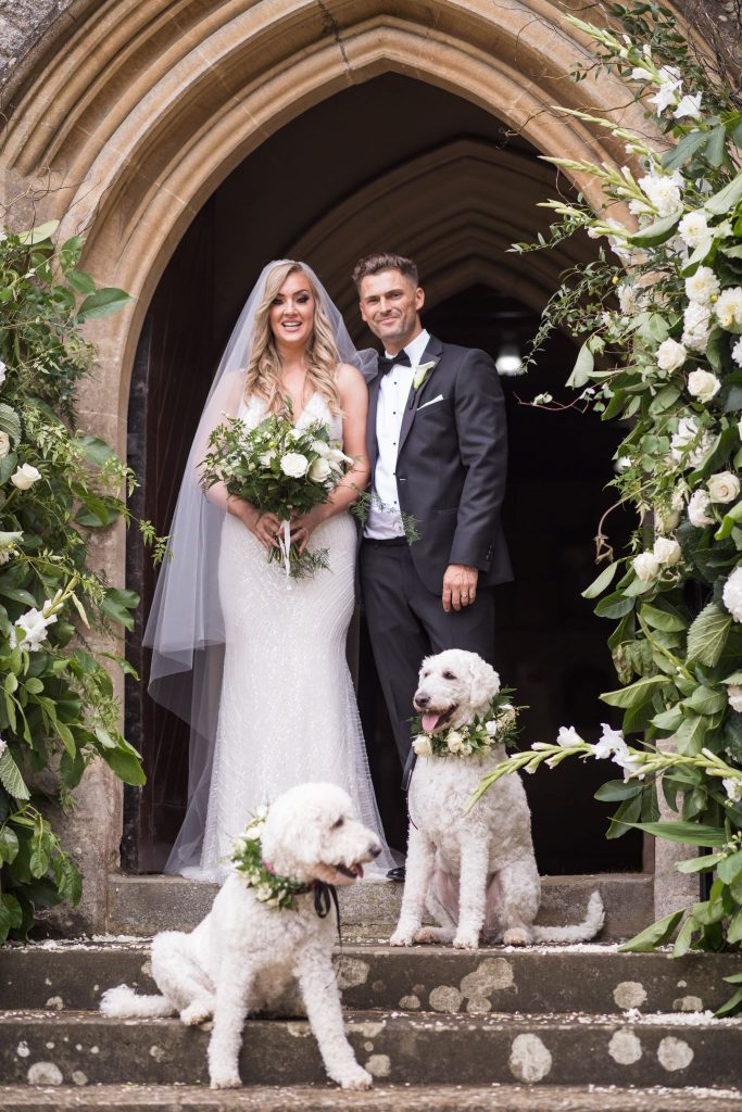 bride groom dogs flower decked archway st marys catholic church husbands bosworth leicestershire oxford wedding photography