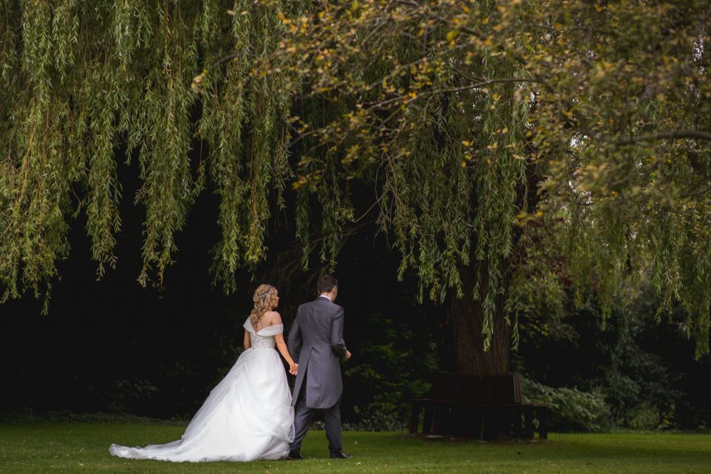 bride groom stroll gardens wroxeter hotel shrewsbury shropshire oxfordshire wedding photographers