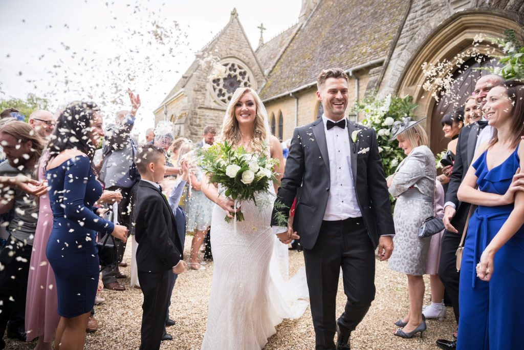 bride groom confetti shower st marys catholic churchyard husbands bosworth leicestershire oxfordshire wedding photographers