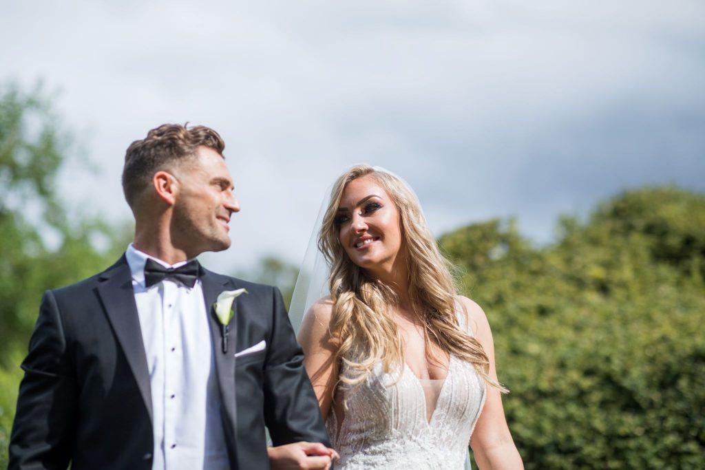 bride groom stroll arm in arm kilworth house hotel north kilworth leicestershire oxford wedding photographer