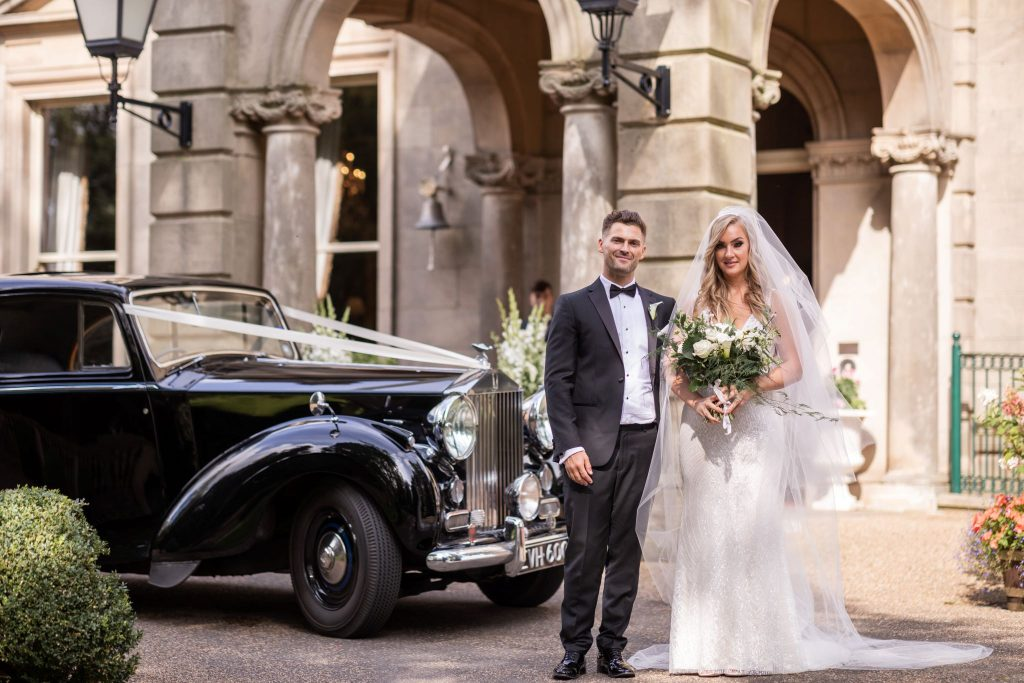 bride groom beside bridal car kilworth house hotel north kilworth leicestershire oxford wedding photographers