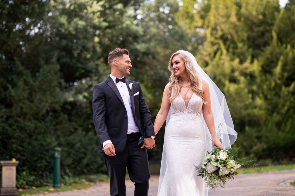 bride groom hand in hand kilworth house hotel grounds north kilworth leicestershire oxfordshire wedding photographer