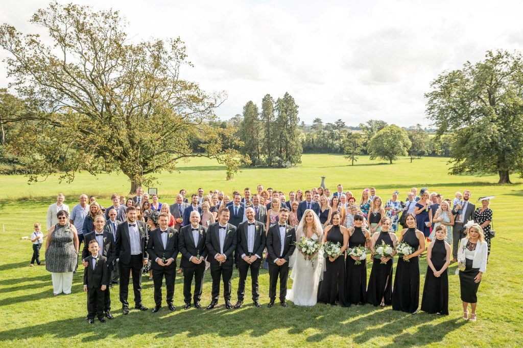bride groom bridesmaids guests formal group portrait kilworth house hotel grounds north kilworth leicestershire oxfordshire wedding photography