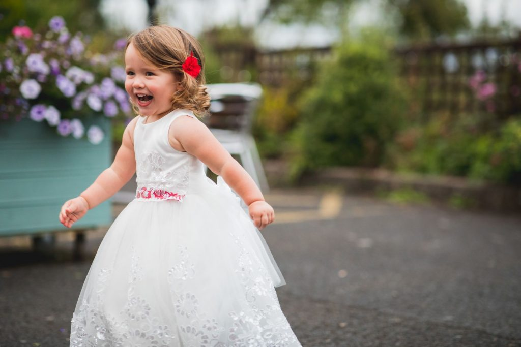 running flowergirl wroxeter hotel gardens shrewsbury shropshire oxford wedding photographer
