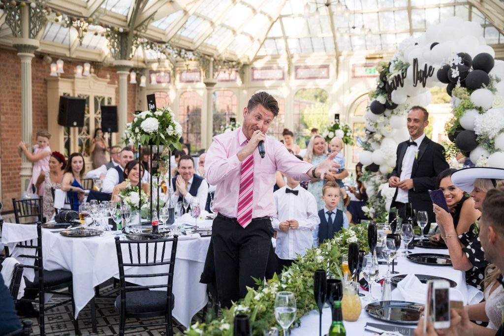 singing waiter entertains kilworth house hotel dinner reception north kilworth leicestershire oxford wedding photographer