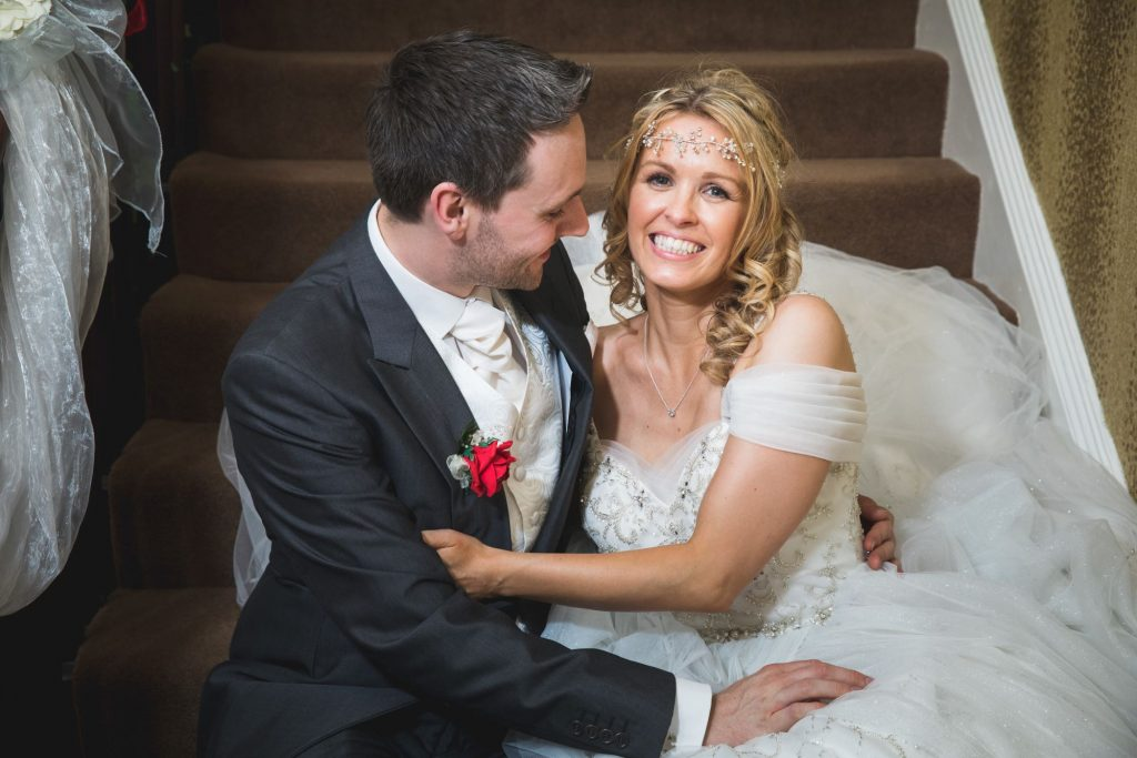 bride groom cuddle wroxeter hotel staircase shrewsbury shropshire oxford wedding photography