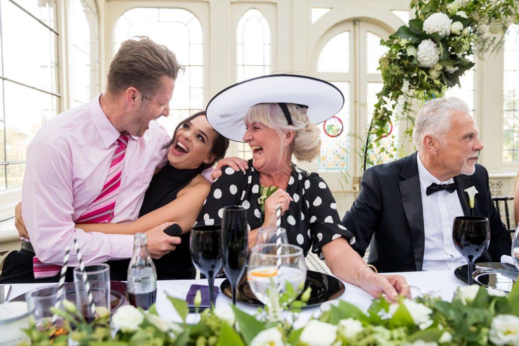 laughing guests enjoy singing waiter kilworth house hotel orangery reception north kilworth leicestershire oxford wedding photographers