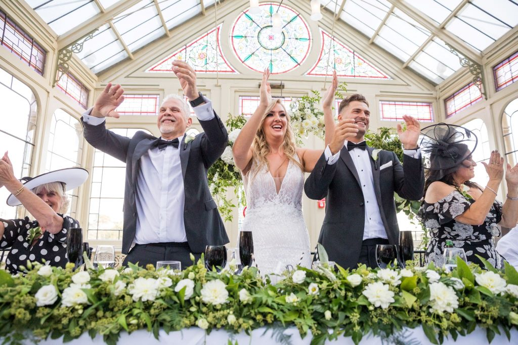 bride groom top table guests applaud entertainer kilworth house hotel orangery north kilworth leicestershire oxford wedding photographers