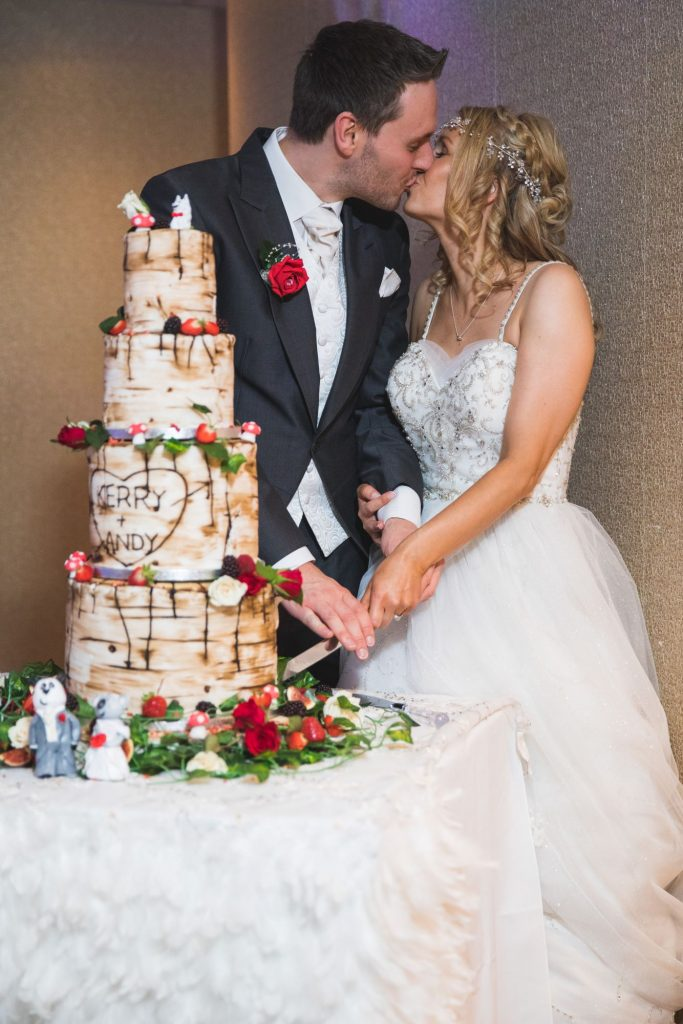 bride groom kiss cake cutting ceremony wroxeter hotel shrewsbury shropshire oxfordshire wedding photography