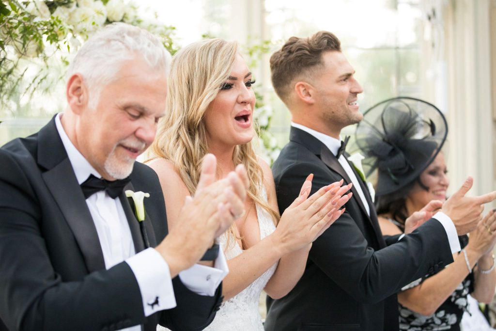 bride groom father of bride mother of groom applaud entertainer kilworth house hotel orangery north kilworth leicestershire oxfordshire wedding photographer