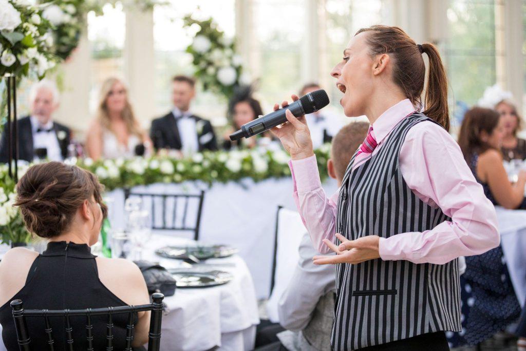 smiling guests enjoy singing waitress kilworth house hotel north kilworth leicestershire oxfordshire wedding photographers
