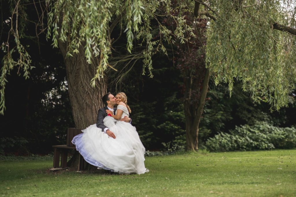 bride groom cuddle wroxeter hotel gardens shrewsbury oxford wedding photographers