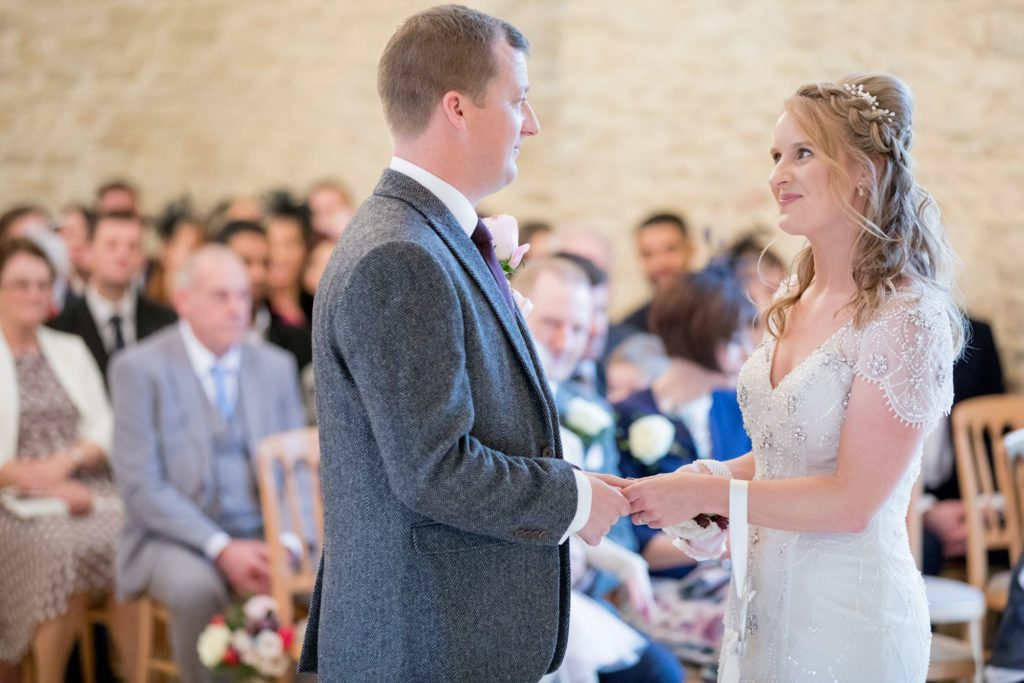 bride groom exchange vows kingscote barn venue tetbury oxford wedding photography