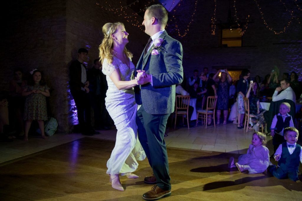 bride grooms first dance kingscote barn venue tetbury oxfordshire wedding photographers