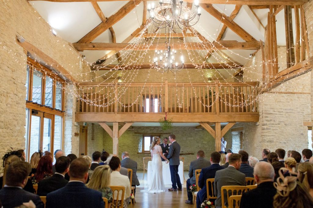 bride grooms marriage ceremony kingscote barn tetbury oxford wedding photographers