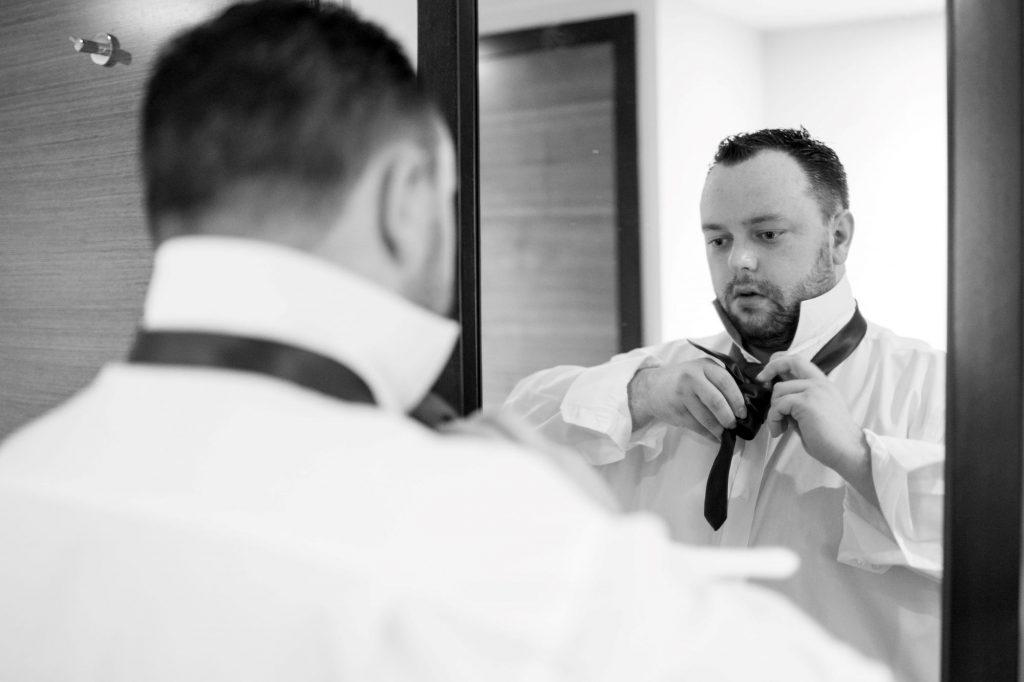 groom ties neck tie sir christopher wren hotel windsor oxford wedding photographers