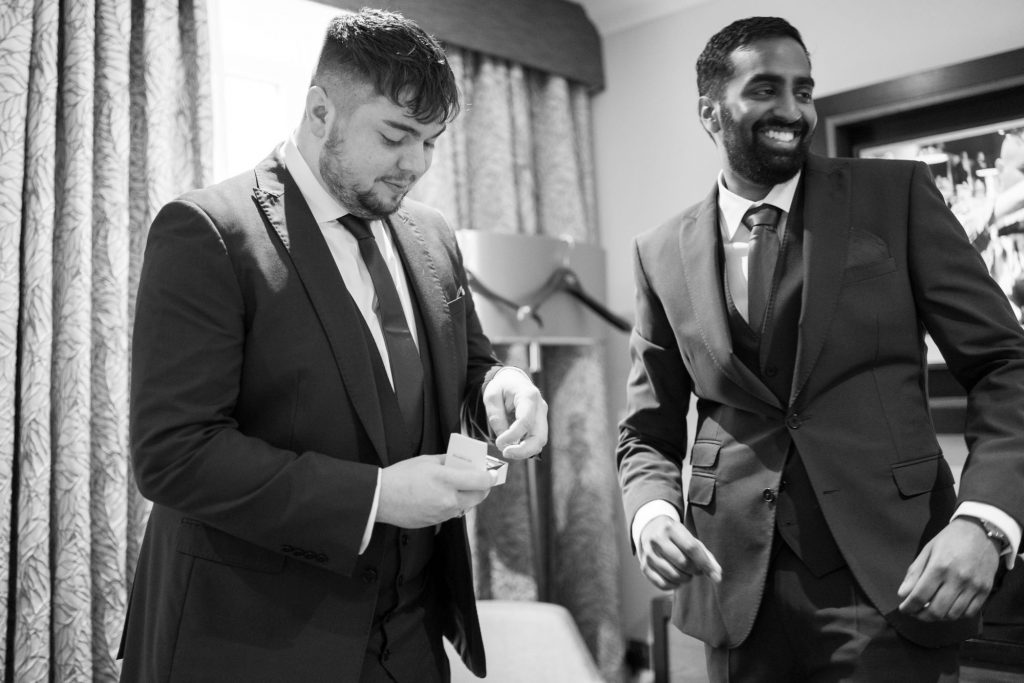 bestman checks ring sir christopher wren hotel windsor oxford wedding photography