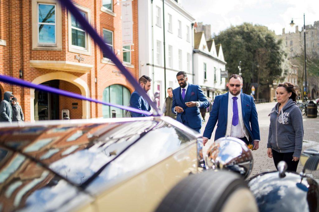 groom groomsmen view bridal car windsor street oxfordshire wedding photographers
