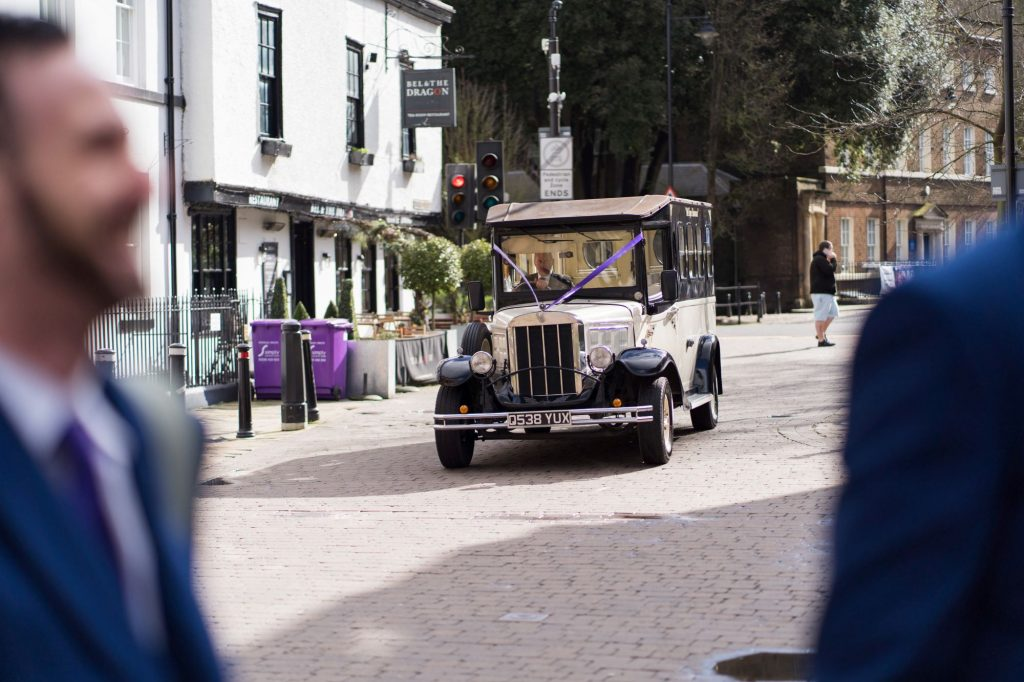grooms party view bridesmaids car windsor street oxfordshire wedding photography