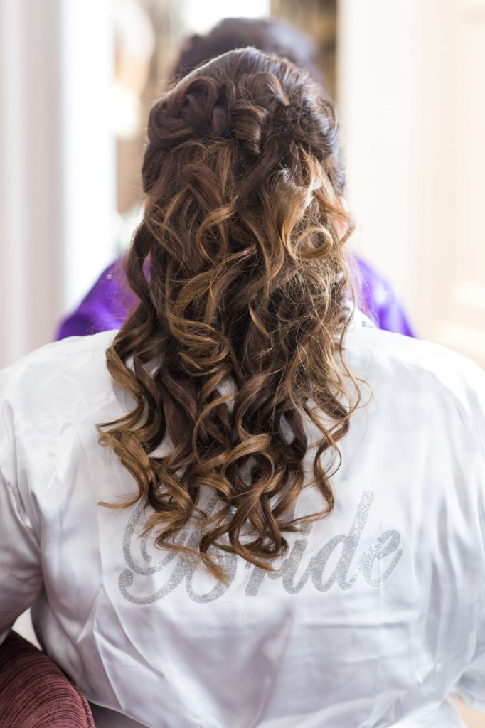 bride completes hair styling bridal prep sir christoper wren hotel windsor oxford wedding photographer