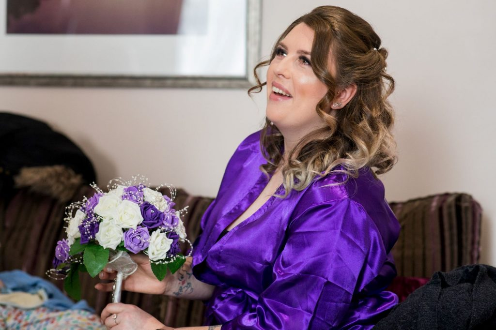 laughing bridesmaid with bouquet sir christopher wren hotel windsor oxford wedding photography