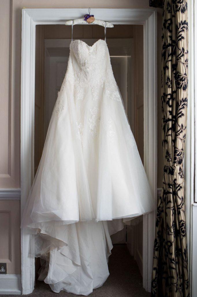 brides dress hanger bridal preparation sir christopher wren hotel windsor oxfordshire wedding photographers