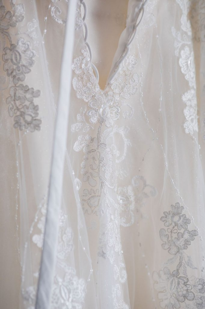 embroidery detail brides dress sir christopher wren hotel windsor oxfordshire wedding photography