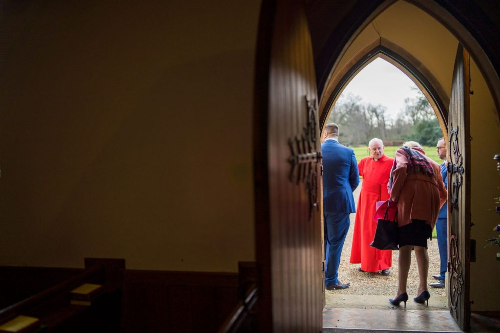 wedding party await bride royal chapel windsor great park marriage ceremony oxfordshire wedding photography