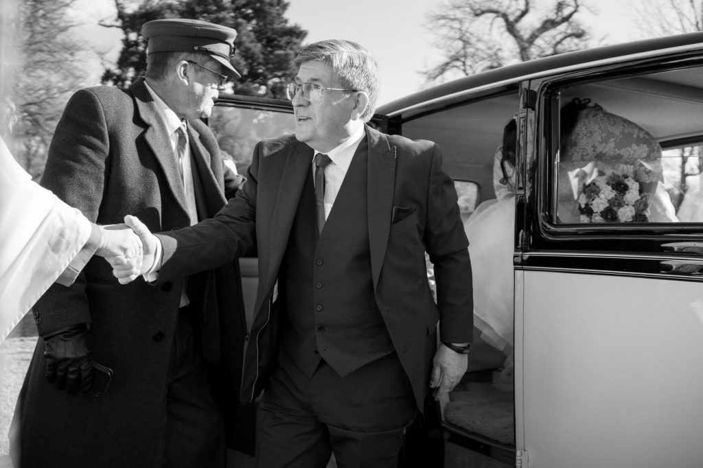 priest greets father of bride royal chapel windsor great park marriage ceremony oxford wedding photographer