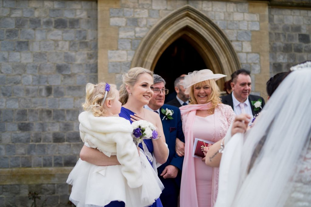 smiling guests greet just married bride royal chapel windsor great park berkshire oxfordshire wedding photographer