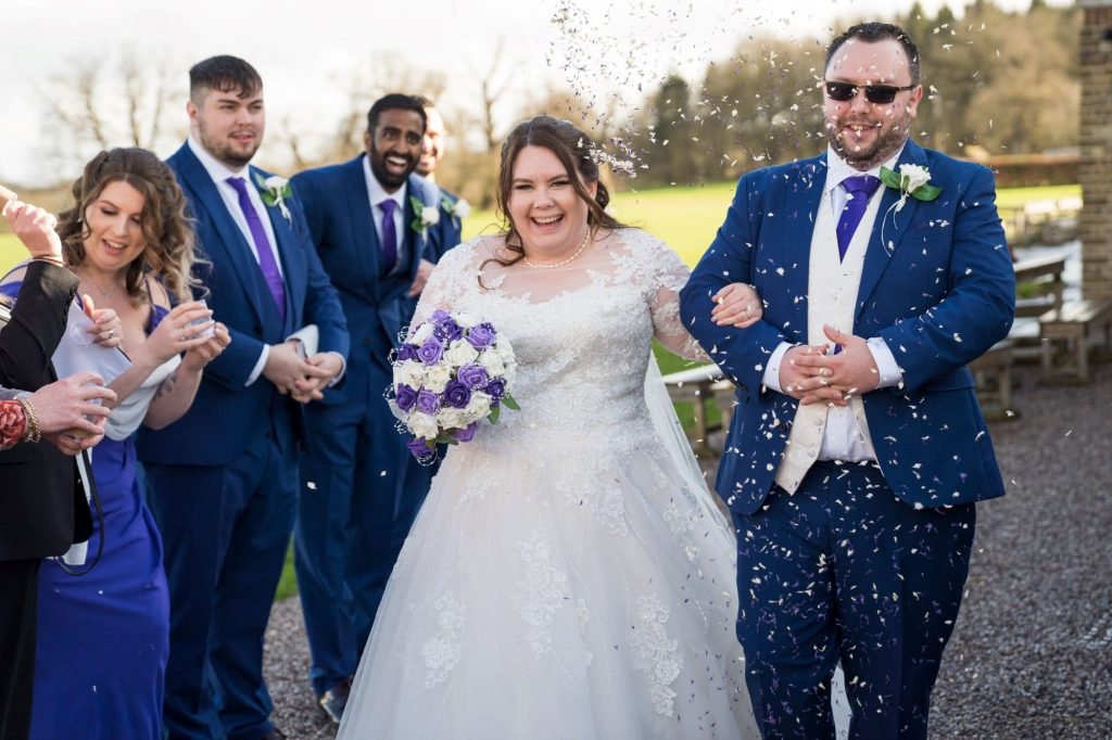 groomsmens confetti shower royal chapel windsor great park marriage ceremony berkshire oxfordshire wedding photography