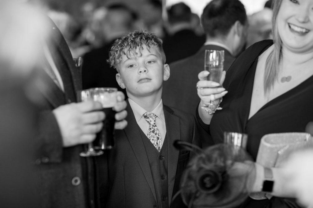 thoughtful young guest reception york club windsor great park berkshire oxfordshire wedding photographer
