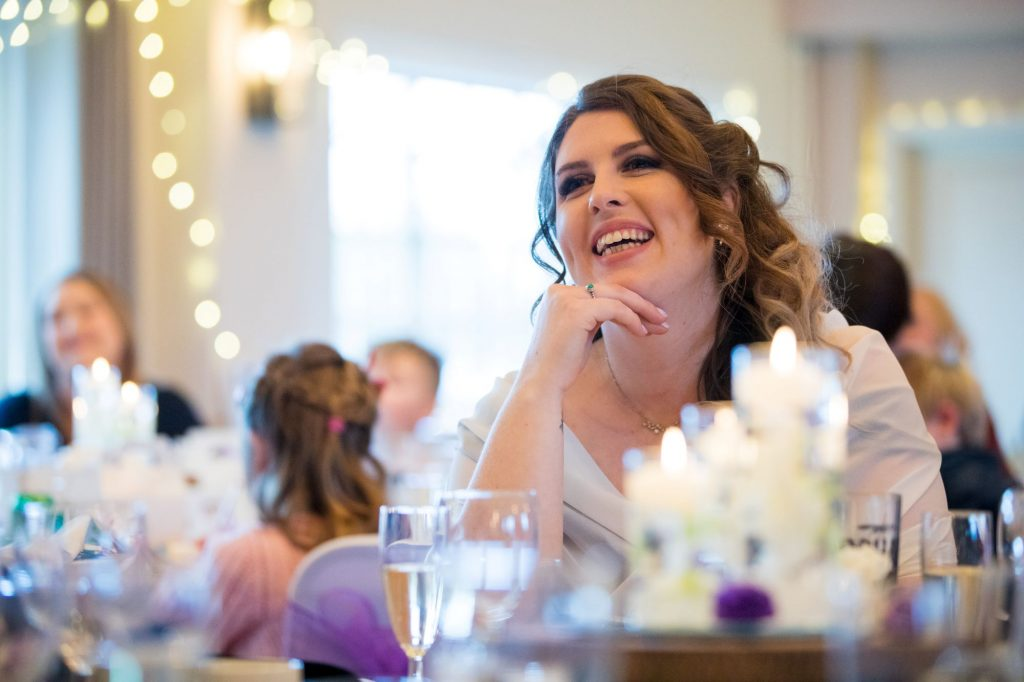 laughing guest hears top table wedding breakfast speech york club windsor great park berkshire oxfordshire wedding photographer