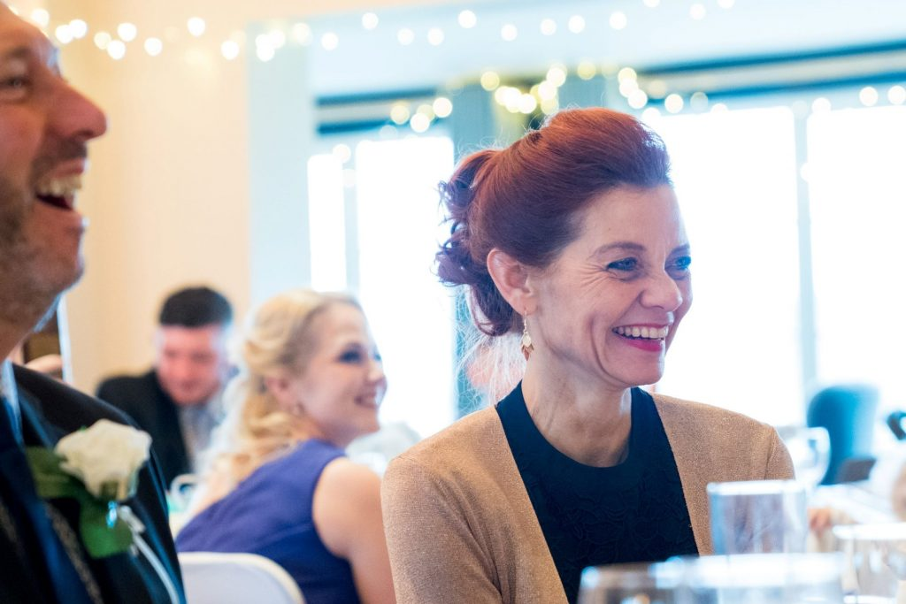 laughing guests hear top table speech york club wedding breaksfast windsor great park berkshire oxford wedding photography