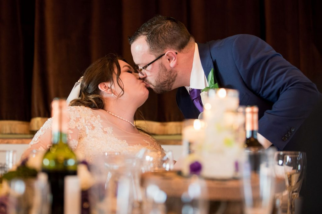 groom kisses bride york club reception windsor great park berkshire oxford wedding photographer