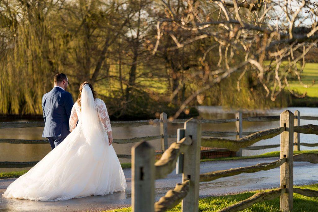 bride groom stroll near york club windsor great park berkshire oxford wedding phototgraphers