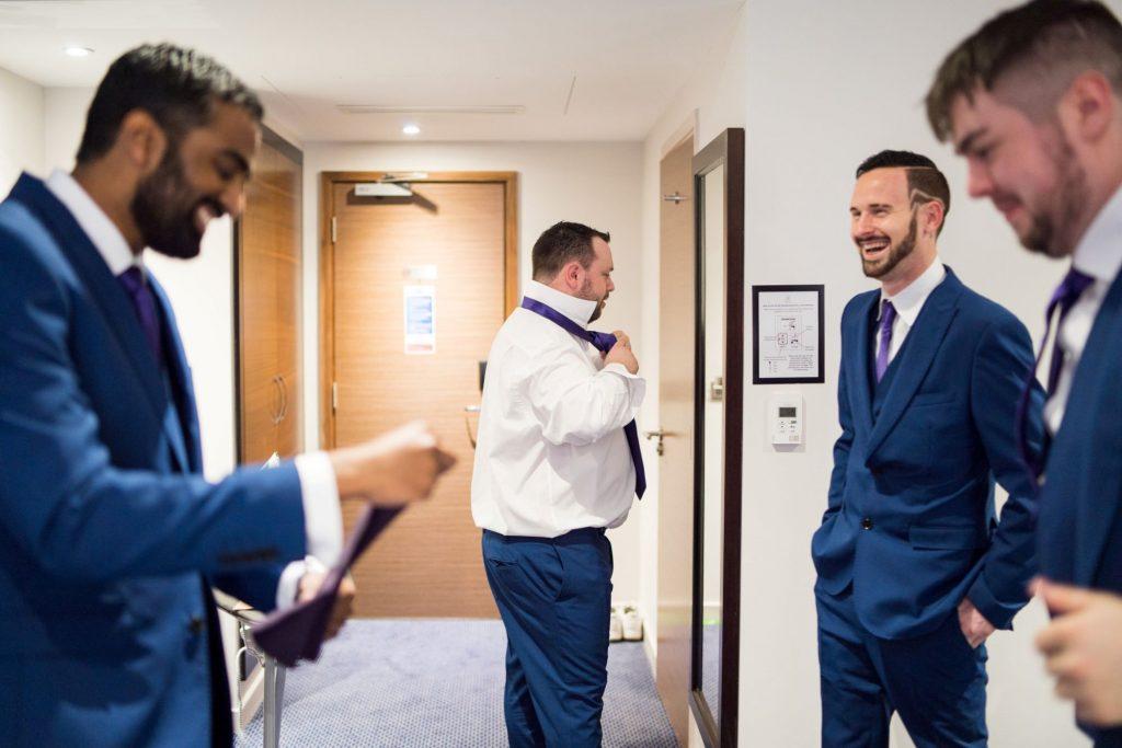 groom groomsmen preparation sir christopher wren hotel windsor oxford wedding photographer