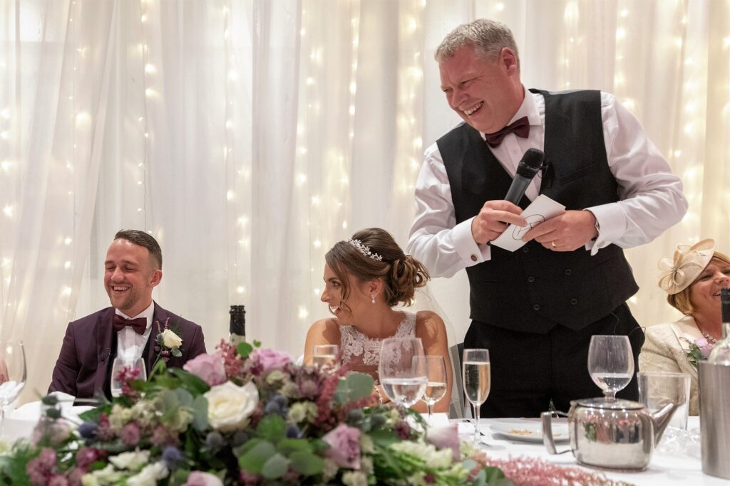 new son in law enjoys father of bride speech milton hill house steventon oxfordshire wedding photographer