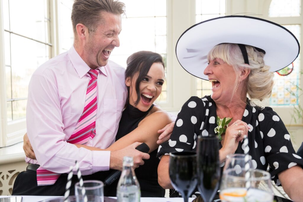 laughing top table guests kilworth house hotel leicestershire oxfordshire wedding photographers
